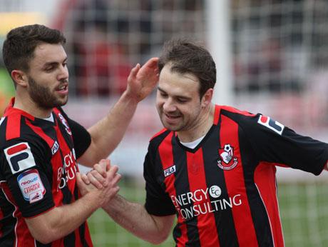 HAT-TRICK HERO: Brett Pitman celebrates with Josh McQuoid on Saturday