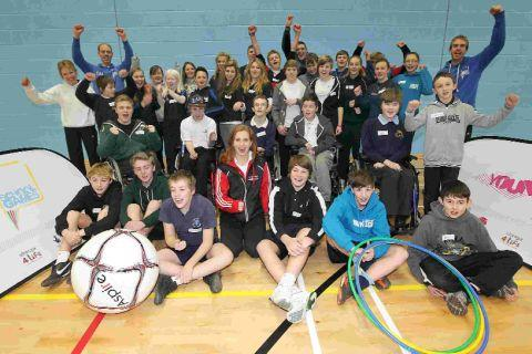 LEADERSHIP LESSON: Paralympic swimmer Kate Grey, centre, with youngsters at The Grange School