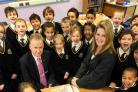 PROUD: Executive head of Queen's Park Academy. Brian Hooper and head of school Alexandra Prout with a Year 3 maths class. Picture: Corin Messer
