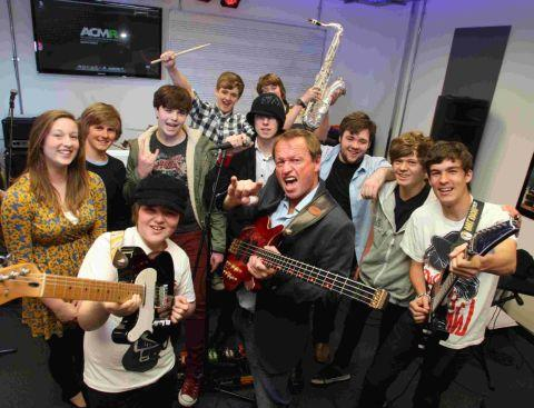 SCALING UP: Pop star Mark King from Level 42 with some of the young prospective students at the Academy of Contemporary Music regional centre in Kinson