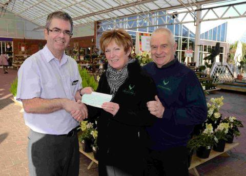 GIFT: Simon Morris of  Ferndown Haskins Garden Centre donates £2,400 to the John Thornton Young Achievers Foundation