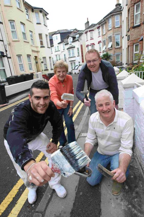 MUCH APPRECIATED: Bart Angus-Hughes with residents of Purbeck Road just after a painting session had