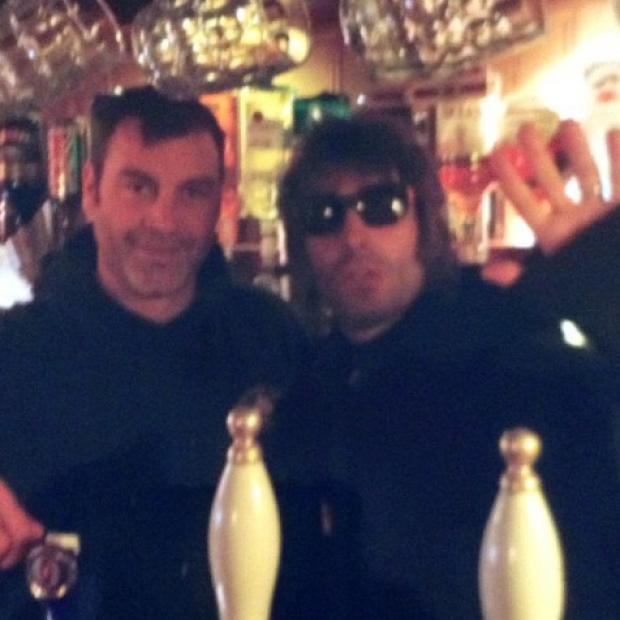 Bournemouth Echo: Liam Gallagher with Andrew Colverson, owner of The Foresters Arms in Brockenhurst