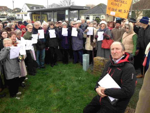 SAVE OUR ROUTE: David Harris with demonstrators at the Southill bus protest