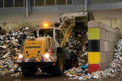 MOUNTING UP: Vehicles at work at Poole's household waste recycling centre on the Nuffield Industrial Estate in Poole