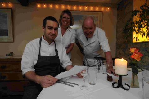 SOMETHING'S COOKING:  Top chef Jack Ingram, left, returns to his roots with chef Gerry and Cathy Craig at Le Petit Canard