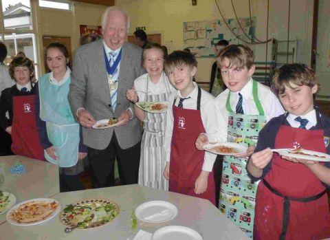 DISHING UP: Mayor of Christchurch, Cllr Peter Hall, with students from St Joseph's Primary School