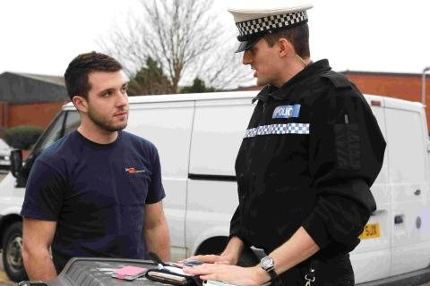 WORD OF ADVICE: PC Mark Palmer, with motorist Josh Mellor who was seen using a mobile phone whilst driving