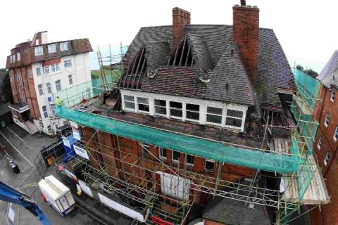 COMING DOWN: Demolition work finally begins on the 'Ritz for Rats', the former St George's Hote