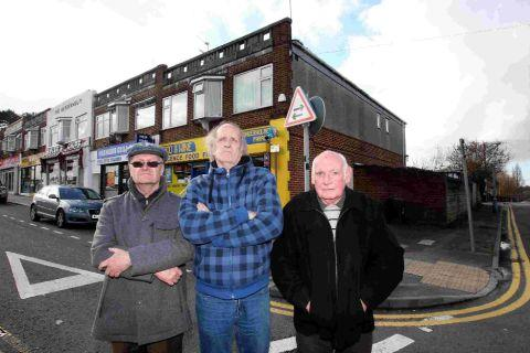 FRUSTRATED: Residents of Acres Road, from left, Martin Allen, residents association chairman Ray Wills and Jim Hurst
