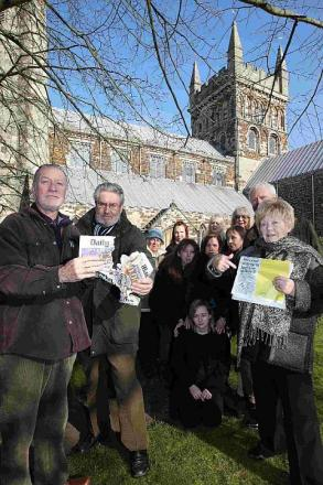 NOT HAPPY: Eileen Worth, chairman of the Wimborne Minster Chamber of Trade and Commerce, right, with a copy of the article and Malcolm Angel and Martin Tidd rip up a copy of the Mail as other angry locals look on