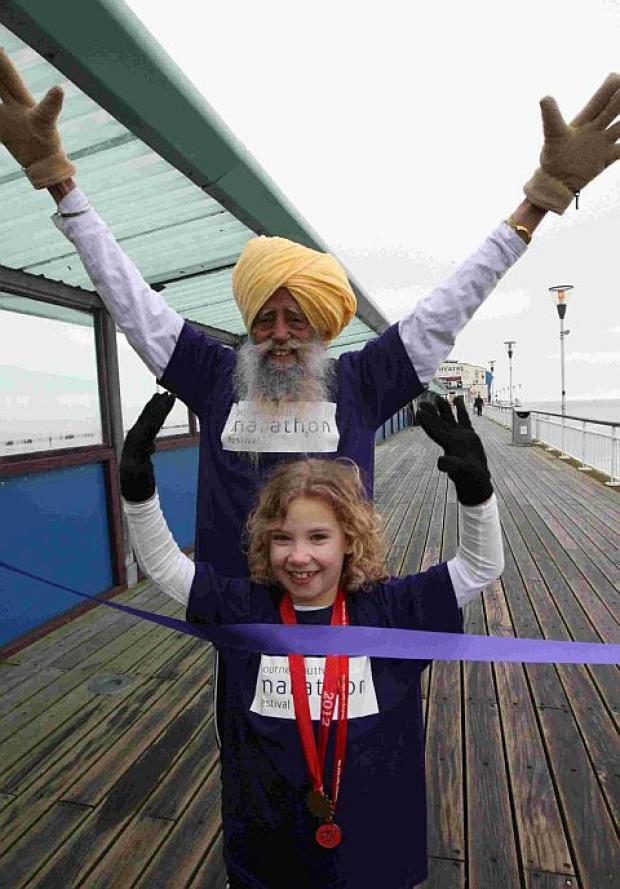 PUTTING IN LEGWORK: Marathon runner Jauja Singh, 101, and Katie Few, 8, from Verwood at the launch of the Marathon Festival