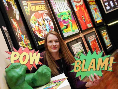 ICONIC IMAGES: Westover Gallery manager Ally Tanswell with some of the Marvel comic covers