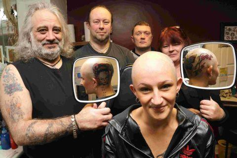 ARTY: Vicki Sampson has her head tattooed – raising funds in aid of Alopecia UK. She is pictured with supporter Neil Johnson, tattooist Wolfie, boyfriend David Ashford and tattoo parlour assistant Sharon Betterton