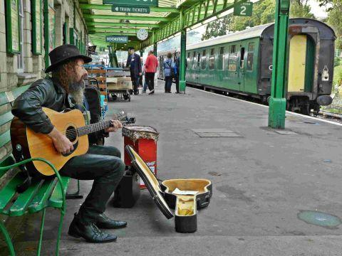 ON SONG: A busker at Swanage station