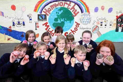 CUP CAKE WINNERS: Pupils from Hamworthy Middle School hold a bake sale in aid of children's bereavement charity Mosaic