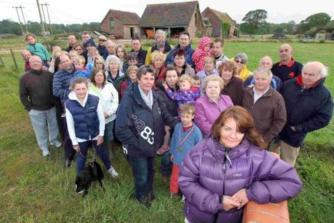 Burton residents led by Alison Ramsay, front, opposed to proposed building of homes on Burton Farm