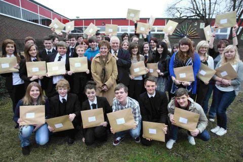 HAPPY DAY: Peter and Linda Thornton with students at Ferndown Upper School who they had presented with scholarships and bursary awards through the John Thornton Young Achievers Foundation