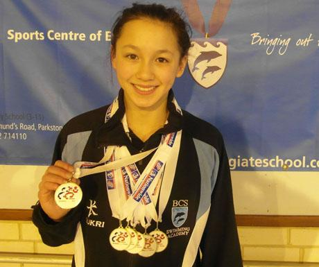 SIX OF THE BEST: Alice Tai with her medal collection in Sheffield