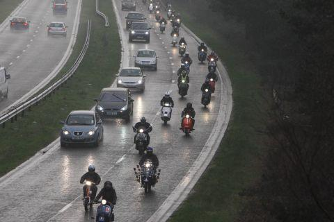 The convoy of scooters and motorcycles heads up the A338 spur road