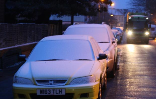 Snow on cars in Boscombe this morning