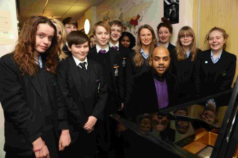 DRIFTING: Ryan King of the Drifters works with students from Winton Arts and Media College and Glenmoor School on songs they will perform with the band on stage at the Pavilion