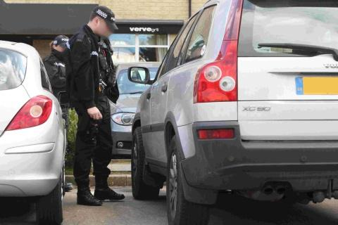 hunt: Armed police officers respond to a report of a damaged Volvo XC90 at the Village Hotel car park in Bournemouth, inset Jade (back) with her brothers and sisters William, 12, Rachel, 9, Danni, 2, and Tommy eight months