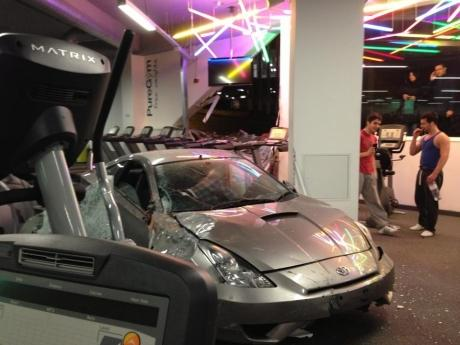 Car smashes through Pure Gym window