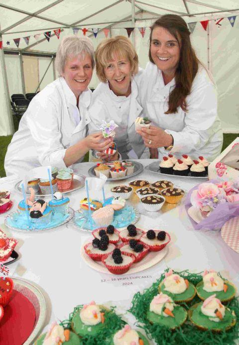TREATS: Jo Wheatley, winner of the 2011 Great British Bake-off, joins fellow judges Jenny Budzynski and Mary Reader in judging the entries in the baking competition