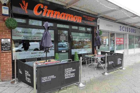 Cinnamon, on Victoria Road, was raided by UK Border Agency staff