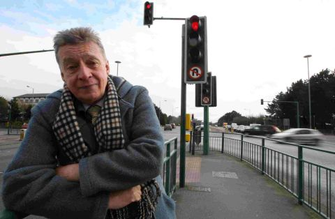 FED-UP: Ian Julian at traffic lights on Castle Lane East where he was caught by a camera driving through a red light