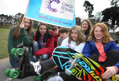WHEELY GOOD: Emily Coleman,12, centre, and friends to promote her Sk8 for Life skateathon