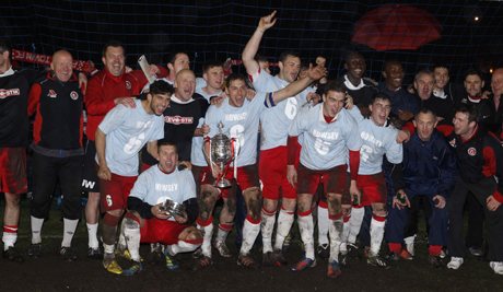 CHAMPS: Poole Town celebrate their cup win tonight