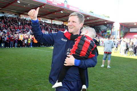 DADDY COOL: Eddie Howe and son Harry celebrate promotion in 2013