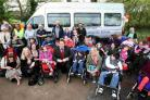 SMILES: Staff, pupils and visitors at Langside School to officially unveil the new school minibus
