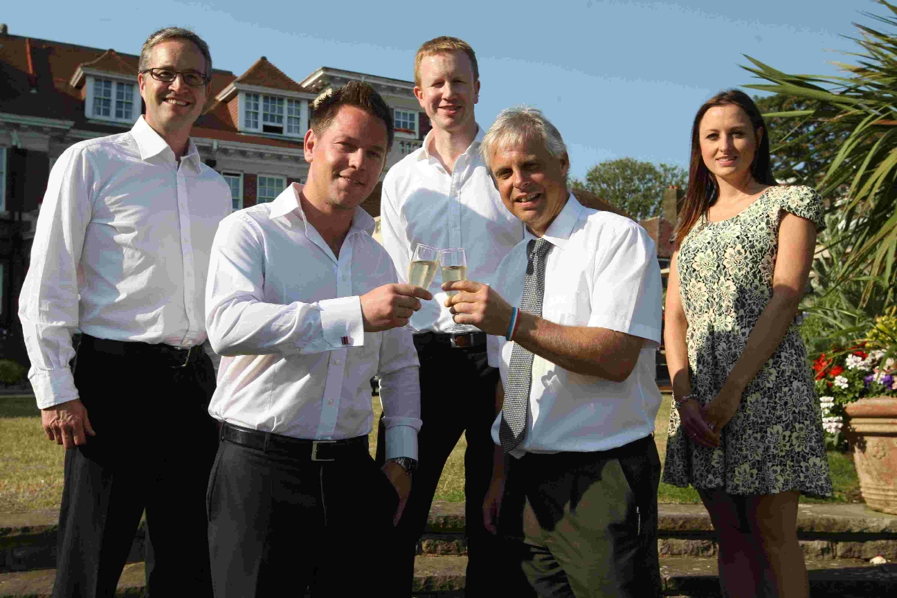 Air Festival director Jon Weaver, front right, toasts new sponsors City Fibre with their National Business Sales Manager Adam Troman