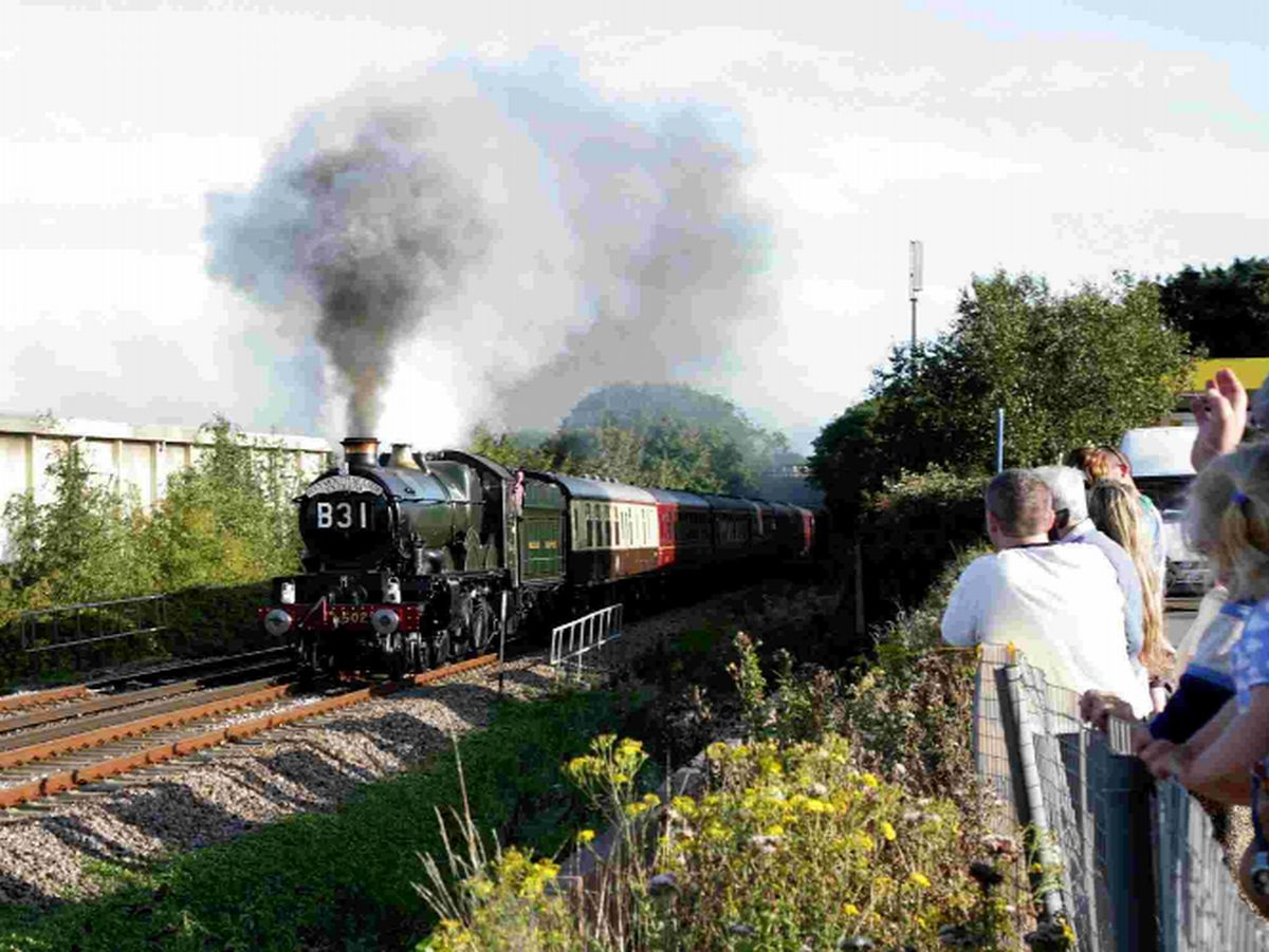 TOO HOT: GWR engine Nunney Castle passing Morrisons car park in Weymouth
