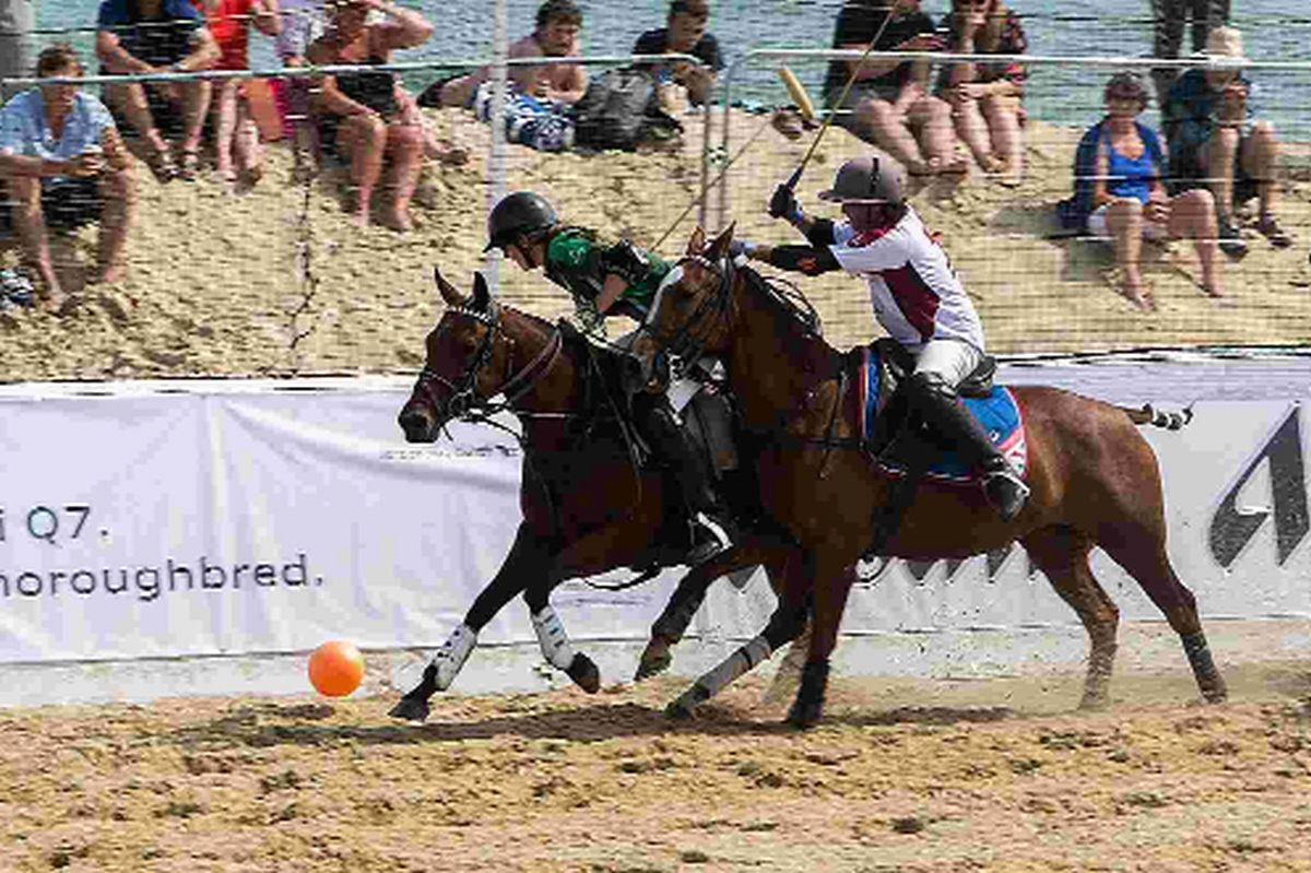 ROUGH AND TUMBLE: Ireland and England do battle on the first day of the Asahi British Beach Polo Championships begins on Sandbanks Beach