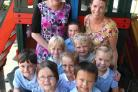 LEADER: Pupils at Stourfield Infant School in Southbourne, with head teacher Cathy Kirkham, left, and deputy head Tracey Edwards