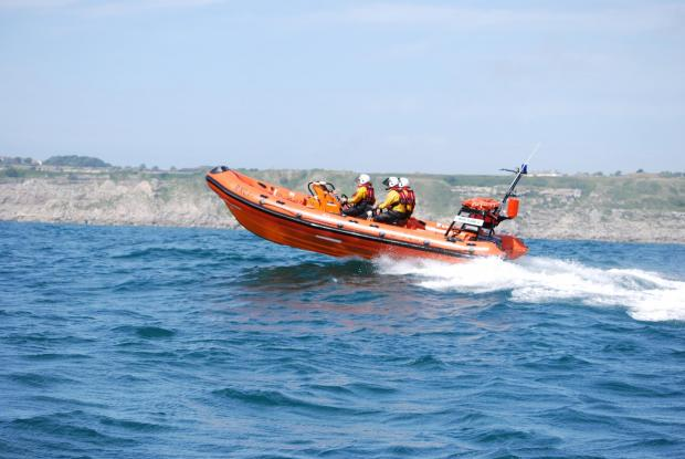 Bournemouth Echo: The Weymouth Lifeboat crew head to help a stricken swimmer
