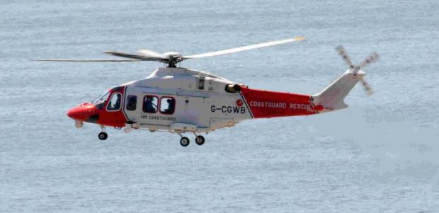 Coastguard helicopter airlifts diver suffering from decompression sickness from Swanage Bay