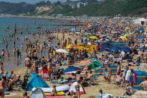 Bournemouth Echo: CROWDS: The beach fills as Bournemouth experiences high temperatures