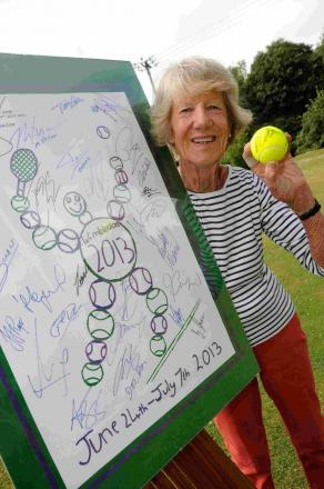 Caroline Temple with the poster signed by Andy Murray