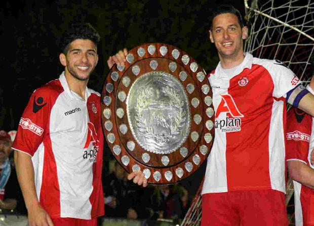 WINNER: Poole Town midfielder Marvin Brooks (left)