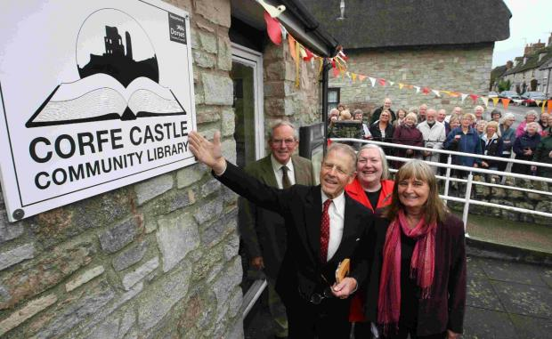 Edward Fox officially opens the new library with George Preston, chairman of the village hall trustees, and Angelika Seik and Alison Allwright from the Friends of Corfe Castle Community Library
