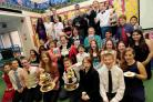 CHEERS: Pupils celebrate the end of their Who Do You Think You Are? project