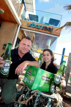 CHEERS: manager James Soulsby and barmaid Claudia Rosario