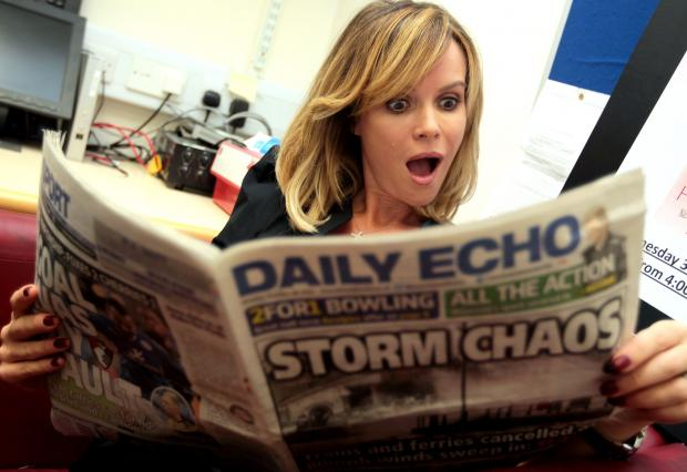 Bournemouth Echo: POPULAR: Amanda Holden catches up on the news at Castlepoint yesterday