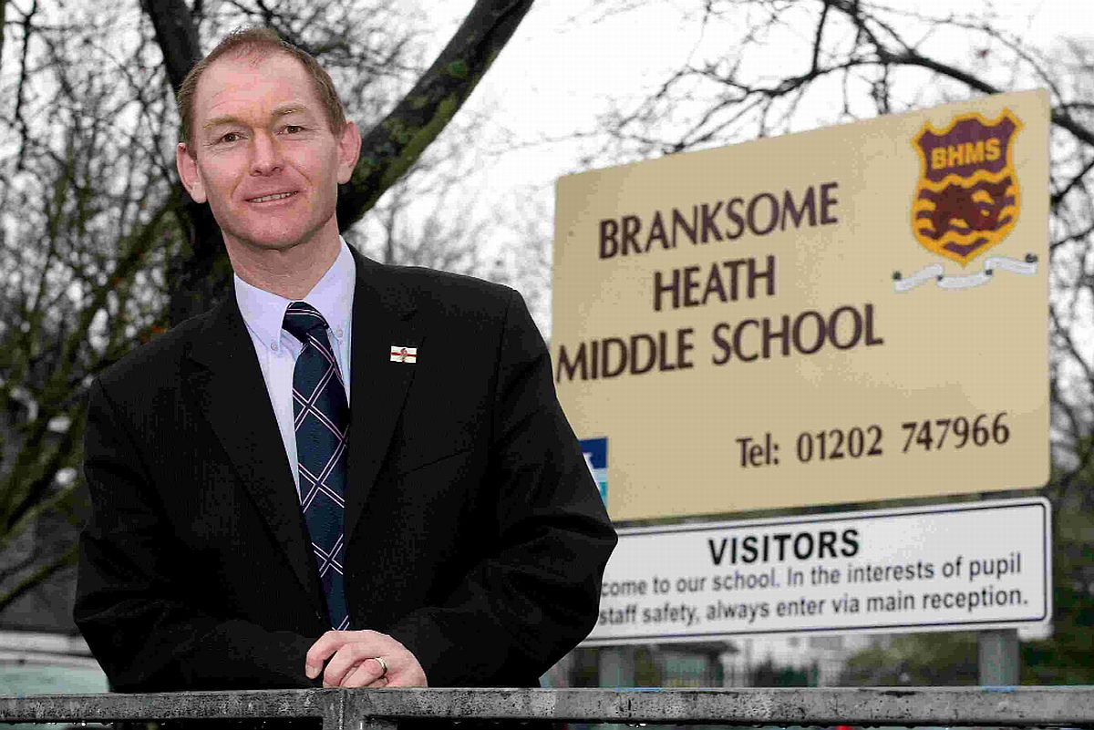 WELCOME: Stuart Fox, headteacher of Branksome Heath Middle School, is pleased with the extension of the  20mph zone around the school