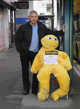 Kevin Old, of the Zip Yard, in Wimborne Road, Winton, with the shop's mascot, Mr Zippy - the subject of a council legal threat